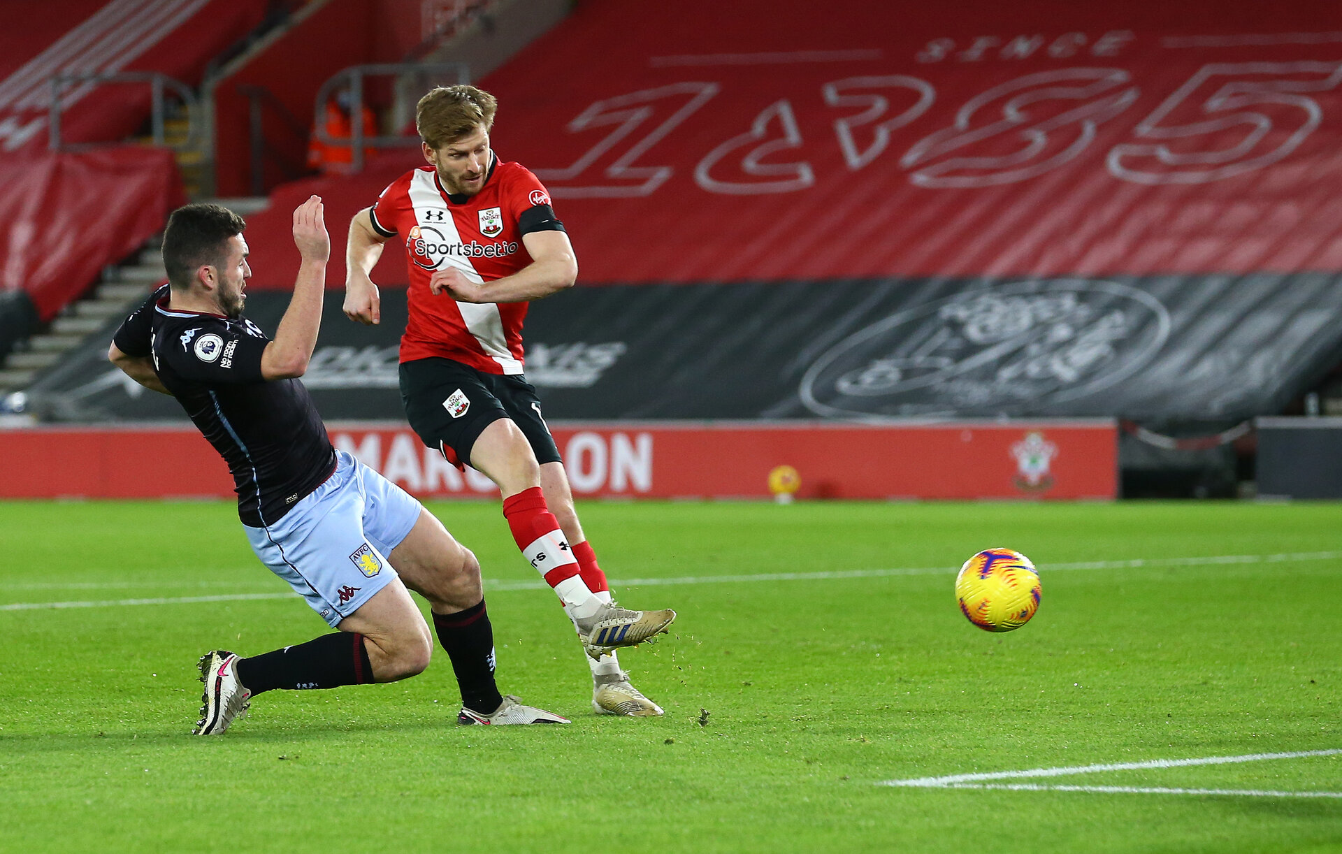 SOUTHAMPTON, ENGLAND - JANUARY 30: Stuart Armstrong of Southampton shoots at goal during the Premier League match between Southampton and Aston Villa at St Mary's Stadium on January 30, 2021 in Southampton, England. Sporting stadiums around the UK remain under strict restrictions due to the Coronavirus Pandemic as Government social distancing laws prohibit fans inside venues resulting in games being played behind closed doors. (Photo by Matt Watson/Southampton FC via Getty Images)