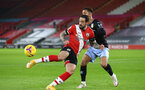 SOUTHAMPTON, ENGLAND - JANUARY 30: Danny Ings (L) of Southampton and Douglas Luiz (R) of Aston Villa during the Premier League match between Southampton and Aston Villa at St Mary's Stadium on January 30, 2021 in Southampton, England. Sporting stadiums around the UK remain under strict restrictions due to the Coronavirus Pandemic as Government social distancing laws prohibit fans inside venues resulting in games being played behind closed doors. (Photo by Matt Watson/Southampton FC via Getty Images)