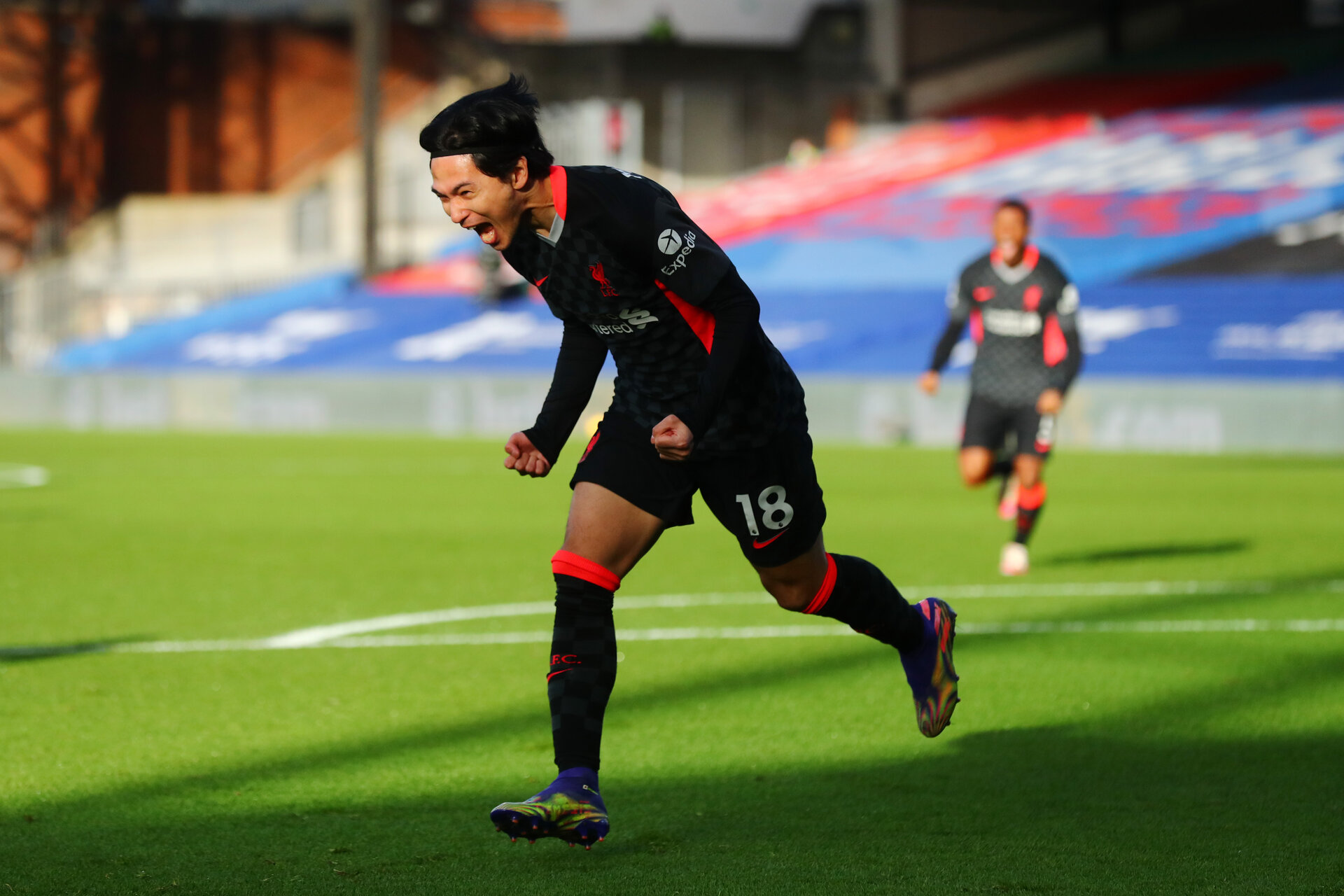 LONDON, ENGLAND - DECEMBER 19:  Takumi Minamino of Liverpool celebrates after scoring their sides first goal during the Premier League match between Crystal Palace and Liverpool at Selhurst Park on December 19, 2020 in London, England. The match will be played without fans, behind closed doors as a Covid-19 precaution. (Photo by Clive Rose/Getty Images)
