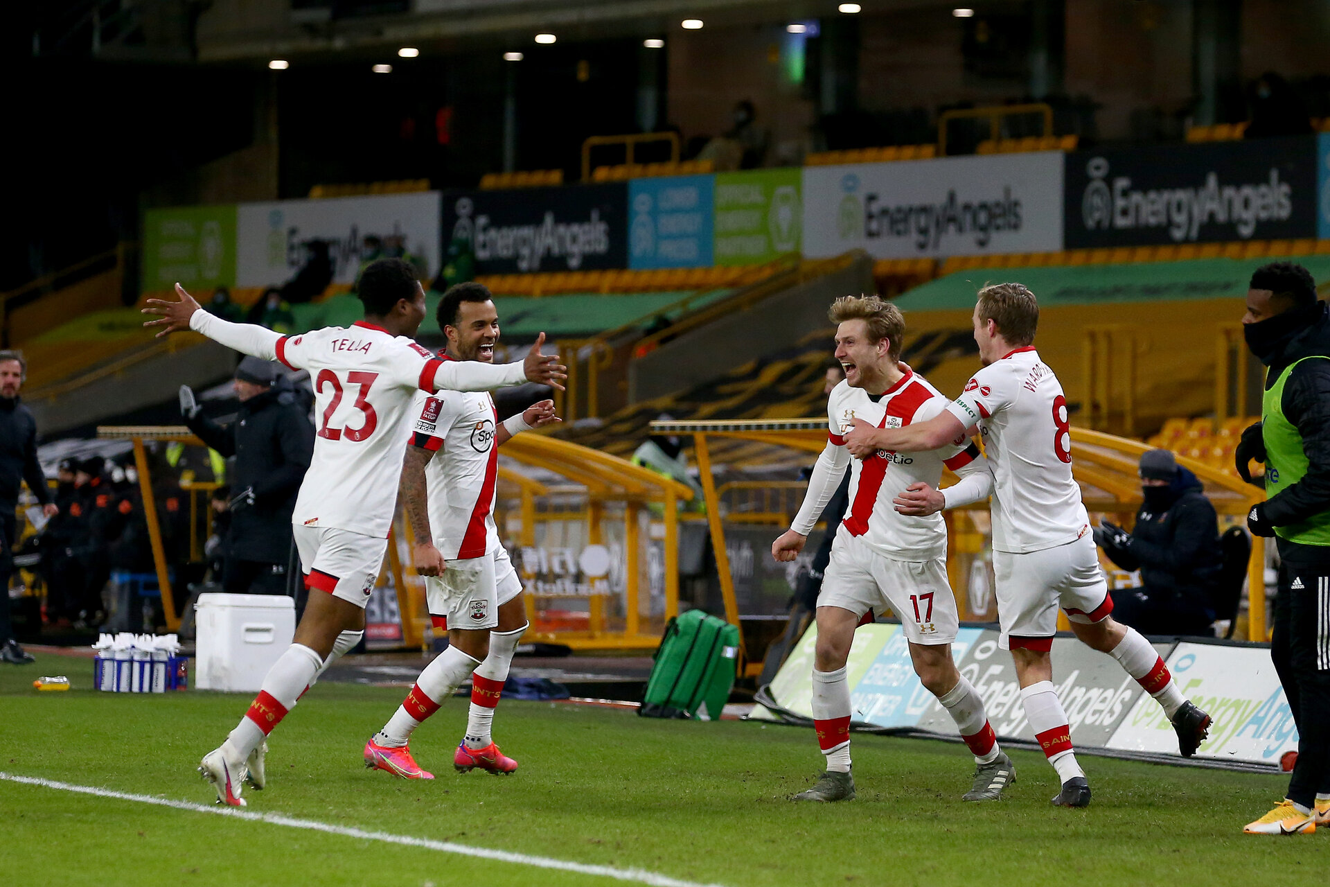 WOLVERHAMPTON, ENGLAND - FEBRUARY 11: Stuart Armstrong of Southampton scores and celebrates with team mates during The Emirates FA Cup Fifth Round match between Wolverhampton Wanderers and Southampton at Molineux on February 11, 2021 in Wolverhampton, England. Sporting stadiums around the UK remain under strict restrictions due to the Coronavirus Pandemic as Government social distancing laws prohibit fans inside venues resulting in games being played behind closed doors. (Photo by Matt Watson/Southampton FC via Getty Images)