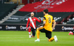 SOUTHAMPTON, ENGLAND - FEBRUARY 14: Nathan Redmond of Southampton taking a knee in support of the Black Lives Matter movement during the Premier League match between Southampton and Wolverhampton Wanderers at St Mary's Stadium on February 14, 2021 in Southampton, England. Sporting stadiums around the UK remain under strict restrictions due to the Coronavirus Pandemic as Government social distancing laws prohibit fans inside venues resulting in games being played behind closed doors. (Photo by Matt Watson/Southampton FC via Getty Images)