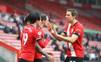 SOUTHAMPTON, ENGLAND - FEBRUARY 14: Danny Ings of Southampton celebrates scoring with his team mates during the Premier League match between Southampton and Wolverhampton Wanderers at St Mary's Stadium on February 14, 2021 in Southampton, England. Sporting stadiums around the UK remain under strict restrictions due to the Coronavirus Pandemic as Government social distancing laws prohibit fans inside venues resulting in games being played behind closed doors. (Photo by Matt Watson/Southampton FC via Getty Images)