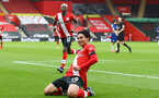 SOUTHAMPTON, ENGLAND - FEBRUARY 20: Takumi Minamino of Southampton goal celebration during the Premier League match between Southampton and Chelsea at St Mary's Stadium on February 20, 2021 in Southampton, England. Sporting stadiums around the UK remain under strict restrictions due to the Coronavirus Pandemic as Government social distancing laws prohibit fans inside venues resulting in games being played behind closed doors. (Photo by Matt Watson/Southampton FC via Getty Images)