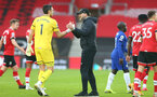 SOUTHAMPTON, ENGLAND - FEBRUARY 20: Alex McCarthy (L) of Southampton and Ralph Hasenhuttl during the Premier League match between Southampton and Chelsea at St Mary's Stadium on February 20, 2021 in Southampton, England. Sporting stadiums around the UK remain under strict restrictions due to the Coronavirus Pandemic as Government social distancing laws prohibit fans inside venues resulting in games being played behind closed doors. (Photo by Matt Watson/Southampton FC via Getty Images)
