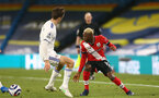 LEEDS, ENGLAND - FEBRUARY 23: Moussa Djenepo (R) of Southampton during the Premier League match between Leeds United and Southampton at Elland Road on February 23, 2021 in Leeds, England. Sporting stadiums around the UK remain under strict restrictions due to the Coronavirus Pandemic as Government social distancing laws prohibit fans inside venues resulting in games being played behind closed doors. (Photo by Matt Watson/Southampton FC via Getty Images)