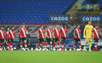 LIVERPOOL, ENGLAND - MARCH 01: Southampton players walking out ahead of the Premier League match between Everton and Southampton at Goodison Park on March 01, 2021 in Liverpool, England. Sporting stadiums around the UK remain under strict restrictions due to the Coronavirus Pandemic as Government social distancing laws prohibit fans inside venues resulting in games being played behind closed doors. (Photo by Matt Watson/Southampton FC via Getty Images)