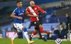 LIVERPOOL, ENGLAND - MARCH 01: Mason Holgate (L) of Everton and Nathan Redmond (R) of Southampton during the Premier League match between Everton and Southampton at Goodison Park on March 01, 2021 in Liverpool, England. Sporting stadiums around the UK remain under strict restrictions due to the Coronavirus Pandemic as Government social distancing laws prohibit fans inside venues resulting in games being played behind closed doors. (Photo by Matt Watson/Southampton FC via Getty Images)
