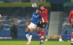 LIVERPOOL, ENGLAND - MARCH 01: Dominic Calvert-Lewin (L) of Everton and Jannik Vestergaard (R) of Southampton during the Premier League match between Everton and Southampton at Goodison Park on March 01, 2021 in Liverpool, England. Sporting stadiums around the UK remain under strict restrictions due to the Coronavirus Pandemic as Government social distancing laws prohibit fans inside venues resulting in games being played behind closed doors. (Photo by Matt Watson/Southampton FC via Getty Images)