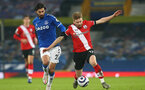 LIVERPOOL, ENGLAND - MARCH 01: Andre Gomes (L) of Everton and Stuart Armstrong (R) of Southampton during the Premier League match between Everton and Southampton at Goodison Park on March 01, 2021 in Liverpool, England. Sporting stadiums around the UK remain under strict restrictions due to the Coronavirus Pandemic as Government social distancing laws prohibit fans inside venues resulting in games being played behind closed doors. (Photo by Matt Watson/Southampton FC via Getty Images)