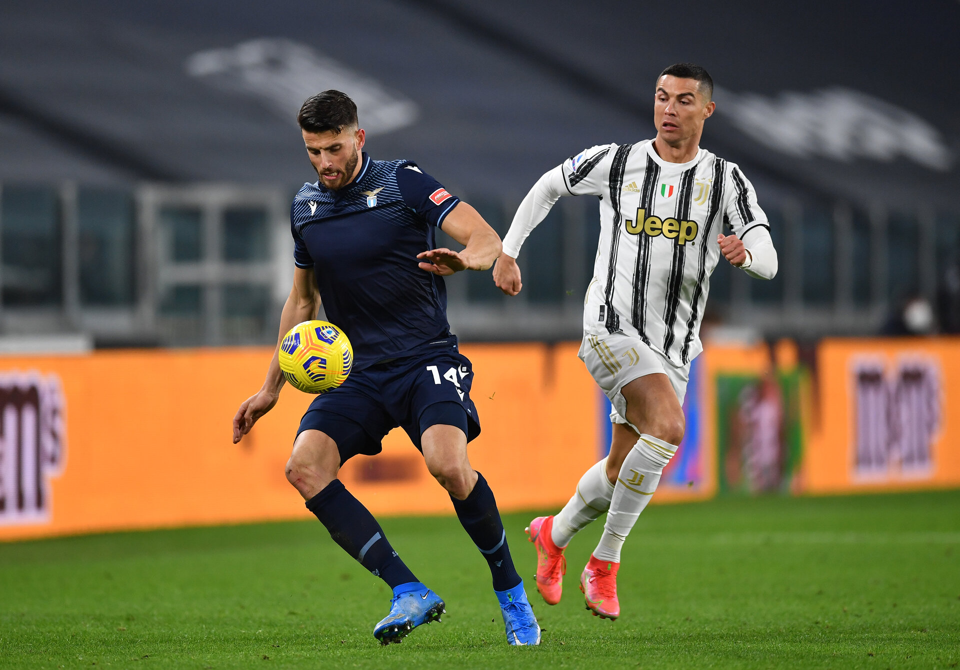 TURIN, ITALY - MARCH 06: Wesley Hoedt of SS Lazio is chased by Cristiano Ronaldo of Juventus  during the Serie A match between Juventus  and SS Lazio at Allianz Stadium on March 06, 2021 in Turin, Italy. Sporting stadiums around Italy remain under strict restrictions due to the Coronavirus Pandemic as Government social distancing laws prohibit fans inside venues resulting in games being played behind closed doors. (Photo by Valerio Pennicino/Getty Images)