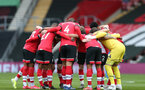 SOUTHAMPTON, ENGLAND - MARCH 14: Southampton players huddle ahead of the Premier League match between Southampton and Brighton & Hove Albion at St Mary's Stadium on March 14, 2021 in Southampton, England. Sporting stadiums around the UK remain under strict restrictions due to the Coronavirus Pandemic as Government social distancing laws prohibit fans inside venues resulting in games being played behind closed doors. (Photo by Matt Watson/Southampton FC via Getty Images)