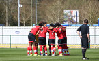 SOUTHAMPTON, ENGLAND - MARCH 27: Southampton players huddle ahead of the Premier League U18s match between Southampton U18 and  Chelsea at Snows Stadium on March 27, 2021 in Southampton, England. (Photo by Isabelle Field/Southamtpon FC)