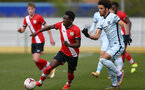 SOUTHAMPTON, ENGLAND - MARCH 27: Kazeem Olaigbe (L) of Southampton during the Premier League U18s match between Southampton U18 and  Chelsea at Snows Stadium on March 27, 2021 in Southampton, England. (Photo by Isabelle Field/Southamtpon FC)