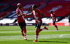 SOUTHAMPTON, ENGLAND - APRIL 04: Nathan Redmond(L) of Southampton and Danny Ings celebrate together during the Premier League match between Southampton and Burnley at St Mary's Stadium on April 04, 2021 in Southampton, England. Sporting stadiums around the UK remain under strict restrictions due to the Coronavirus Pandemic as Government social distancing laws prohibit fans inside venues resulting in games being played behind closed doors. (Photo by Matt Watson/Southampton FC via Getty Images)