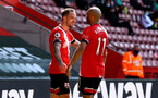 SOUTHAMPTON, ENGLAND - APRIL 04: Danny Ings(L) of Southampton celebrates with team mate Nathan Redmond during the Premier League match between Southampton and Burnley at St Mary's Stadium on April 04, 2021 in Southampton, England. Sporting stadiums around the UK remain under strict restrictions due to the Coronavirus Pandemic as Government social distancing laws prohibit fans inside venues resulting in games being played behind closed doors. (Photo by Matt Watson/Southampton FC via Getty Images)