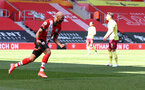 SOUTHAMPTON, ENGLAND - APRIL 04: Nathan Redmond of Southampton celebrates after putting his team 3-2 up during the Premier League match between Southampton and Burnley at St Mary's Stadium on April 04, 2021 in Southampton, England. Sporting stadiums around the UK remain under strict restrictions due to the Coronavirus Pandemic as Government social distancing laws prohibit fans inside venues resulting in games being played behind closed doors. (Photo by Matt Watson/Southampton FC via Getty Images)