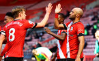 SOUTHAMPTON, ENGLAND - APRIL 04: Nathan Redmond(R) of Southampton celebrates with James Ward-Prowse during the Premier League match between Southampton and Burnley at St Mary's Stadium on April 04, 2021 in Southampton, England. Sporting stadiums around the UK remain under strict restrictions due to the Coronavirus Pandemic as Government social distancing laws prohibit fans inside venues resulting in games being played behind closed doors. (Photo by Matt Watson/Southampton FC via Getty Images)
