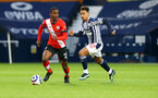 WEST BROMWICH, ENGLAND - APRIL 12: Ibrahima Diallo(L) of Southampton and Dara O'Shea(R) of West Brom during the Premier League match between West Bromwich Albion and Southampton at The Hawthorns on April 12, 2021 in West Bromwich, England. Sporting stadiums around the UK remain under strict restrictions due to the Coronavirus Pandemic as Government social distancing laws prohibit fans inside venues resulting in games being played behind closed doors. (Photo by Matt Watson/Southampton FC via Getty Images)