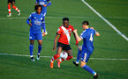 LEICESTER, ENGLAND - APRIL 19: Kazeem Olaigbe (center) of Southampton during the Premier League 2 match between Leicester City and Southampton B Team at the Leicester City Training Ground on April 19, 2021 in Leicester, England.  (Photo by Isabelle Field/Southampton FC via Getty Images)