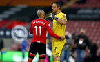 SOUTHAMPTON, ENGLAND - APRIL 30: Nathan Redmond (L) and Alex McCarthy (R) during the Premier League match between Southampton and Leicester City at St Mary's Stadium on April 30, 2021 in Southampton, England. Sporting stadiums around the UK remain under strict restrictions due to the Coronavirus Pandemic as Government social distancing laws prohibit fans inside venues resulting in games being played behind closed doors.  (Photo by Isabelle Field/Southampton FC via Getty Images)