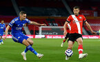 SOUTHAMPTON, ENGLAND - APRIL 30:  Timothy Castagne (L) of  Leicester and Jack Stephens (R) of Southampton during the Premier League match between Southampton and Leicester City at St Mary's Stadium on April 30, 2021 in Southampton, England. Sporting stadiums around the UK remain under strict restrictions due to the Coronavirus Pandemic as Government social distancing laws prohibit fans inside venues resulting in games being played behind closed doors.  (Photo by Isabelle Field/Southampton FC via Getty Images)