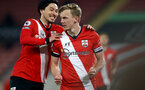 SOUTHAMPTON, ENGLAND - APRIL 30: Takumi Minamino (L) of celebrates with James Ward-Prowse (R) of Southampton after opening the scoring during the Premier League match between Southampton and Leicester City at St Mary's Stadium on April 30, 2021 in Southampton, England. Sporting stadiums around the UK remain under strict restrictions due to the Coronavirus Pandemic as Government social distancing laws prohibit fans inside venues resulting in games being played behind closed doors.  (Photo by Isabelle Field/Southampton FC via Getty Images)