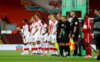 LIVERPOOL, ENGLAND - MAY 08: Southampton players line up ahead of the Premier League match between Liverpool and Southampton at Anfield on May 08, 2021 in Liverpool, England. Sporting stadiums around the UK remain under strict restrictions due to the Coronavirus Pandemic as Government social distancing laws prohibit fans inside venues resulting in games being played behind closed doors. (Photo by Matt Watson/Southampton FC via Getty Images)