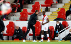 LIVERPOOL, ENGLAND - MAY 08: Ralph Hasenhuttl and (L) Moussa Djenepo (R) of Southampton during the Premier League match between Liverpool and Southampton at Anfield on May 08, 2021 in Liverpool, England. Sporting stadiums around the UK remain under strict restrictions due to the Coronavirus Pandemic as Government social distancing laws prohibit fans inside venues resulting in games being played behind closed doors. (Photo by Matt Watson/Southampton FC via Getty Images)
