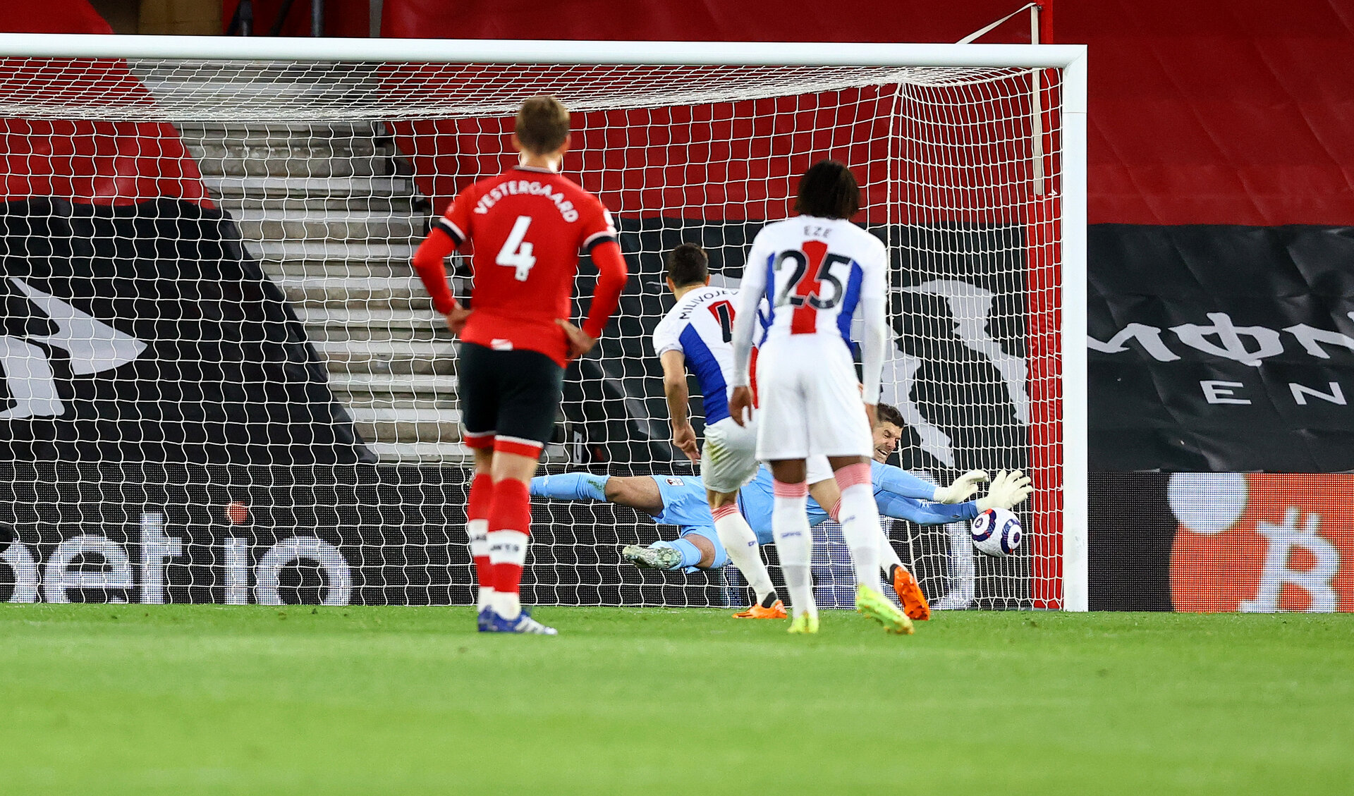 SOUTHAMPTON, ENGLAND - MAY 11: Fraser Forster of Southampton saves a penalty from Luka Milivojevic of Crystal Palace during the Premier League match between Southampton and Crystal Palace at St Mary's Stadium on May 11, 2021 in Southampton, England. Sporting stadiums around the UK remain under strict restrictions due to the Coronavirus Pandemic as Government social distancing laws prohibit fans inside venues resulting in games being played behind closed doors.  (Photo by Matt Watson/Southampton FC via Getty Images)