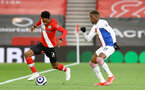 SOUTHAMPTON, ENGLAND - MAY 11: Kyle Walker-Peters (L) of Southampton and Wilfried Zaha (R) of Crystal Palace during the Premier League match between Southampton and Crystal Palace at St Mary's Stadium on May 11, 2021 in Southampton, England. Sporting stadiums around the UK remain under strict restrictions due to the Coronavirus Pandemic as Government social distancing laws prohibit fans inside venues resulting in games being played behind closed doors.  (Photo by Matt Watson/Southampton FC via Getty Images)