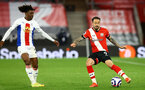 SOUTHAMPTON, ENGLAND - MAY 11: Eberechi Eze (L) of Crystal Palace Danny Ings (R) of Southampton during the Premier League match between Southampton and Crystal Palace at St Mary's Stadium on May 11, 2021 in Southampton, England. Sporting stadiums around the UK remain under strict restrictions due to the Coronavirus Pandemic as Government social distancing laws prohibit fans inside venues resulting in games being played behind closed doors.  (Photo by Matt Watson/Southampton FC via Getty Images)
