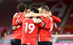 SOUTHAMPTON, ENGLAND - MAY 11: Danny Ings of celebrates with his team mates after making it 3-1 during the Premier League match between Southampton and Crystal Palace at St Mary's Stadium on May 11, 2021 in Southampton, England. Sporting stadiums around the UK remain under strict restrictions due to the Coronavirus Pandemic as Government social distancing laws prohibit fans inside venues resulting in games being played behind closed doors.  (Photo by Matt Watson/Southampton FC via Getty Images)