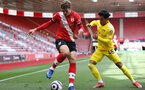SOUTHAMPTON, ENGLAND - MAY 15: Jannik Vestergaard(L) of Southampton and Fabio Carvalho(R) of Fulham during the Premier League match between Southampton and Fulham at St Mary's Stadium on May 15, 2021 in Southampton, England. Sporting stadiums around the UK remain under strict restrictions due to the Coronavirus Pandemic as Government social distancing laws prohibit fans inside venues resulting in games being played behind closed doors.  (Photo by Matt Watson/Southampton FC via Getty Images)