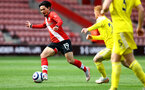 SOUTHAMPTON, ENGLAND - MAY 15: Takumi Minamino(L) of Southampton during the Premier League match between Southampton and Fulham at St Mary's Stadium on May 15, 2021 in Southampton, England. Sporting stadiums around the UK remain under strict restrictions due to the Coronavirus Pandemic as Government social distancing laws prohibit fans inside venues resulting in games being played behind closed doors.  (Photo by Matt Watson/Southampton FC via Getty Images)