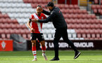 SOUTHAMPTON, ENGLAND - MAY 15: Theo Walcott(L) of Southampton and Ralph Hasenhuttl(R) during the Premier League match between Southampton and Fulham at St Mary's Stadium on May 15, 2021 in Southampton, England. Sporting stadiums around the UK remain under strict restrictions due to the Coronavirus Pandemic as Government social distancing laws prohibit fans inside venues resulting in games being played behind closed doors.  (Photo by Matt Watson/Southampton FC via Getty Images)