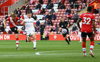 SOUTHAMPTON, ENGLAND - MAY 18: Stuart Armstrong(L) of Southampton shoots at goal while under pressure from Kalvin Phillips(R) of Leeds during the Premier League match between Southampton and Leeds United at St Mary's Stadium on May 18, 2021 in Southampton, England. (Photo by Matt Watson/Southampton FC via Getty Images)