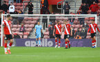 SOUTHAMPTON, ENGLAND - MAY 18: Southampton players after conceding during the Premier League match between Southampton and Leeds United at St Mary's Stadium on May 18, 2021 in Southampton, England. (Photo by Matt Watson/Southampton FC via Getty Images)