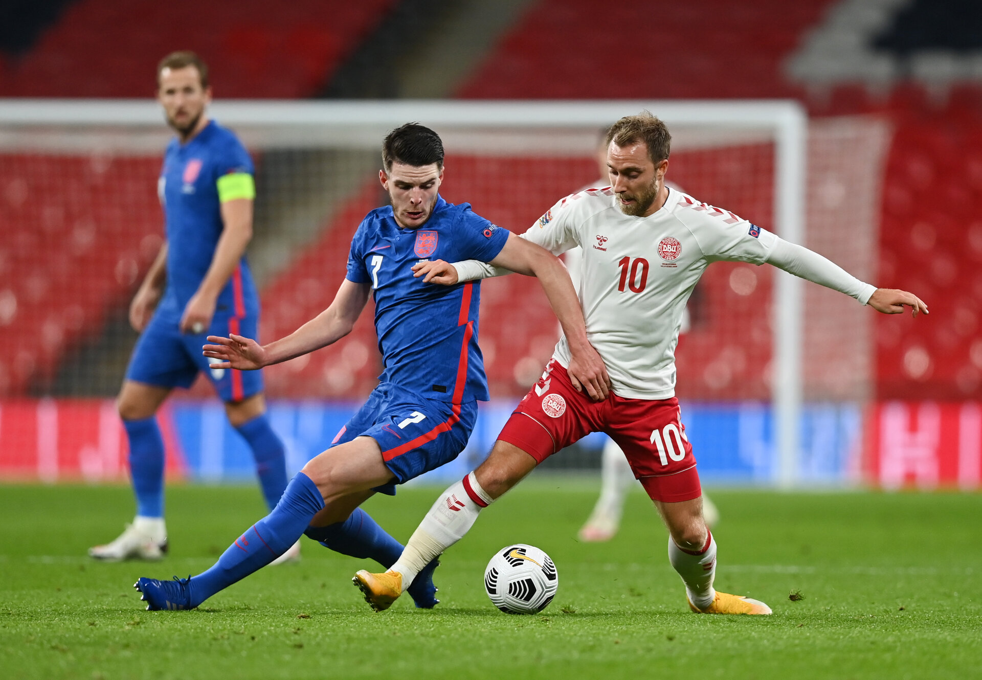 LONDON, ENGLAND - OCTOBER 14: Declan Rice of England  battles for possession with  Christian Eriksen of Denmark  during the UEFA Nations League group stage match between England and Denmark at Wembley Stadium on October 14, 2020 in London, England. Football Stadiums around Europe remain empty due to the Coronavirus Pandemic as Government social distancing laws prohibit fans inside venues resulting in fixtures being played behind closed doors. (Photo by Daniel Leal Olivas - Pool/Getty Images)