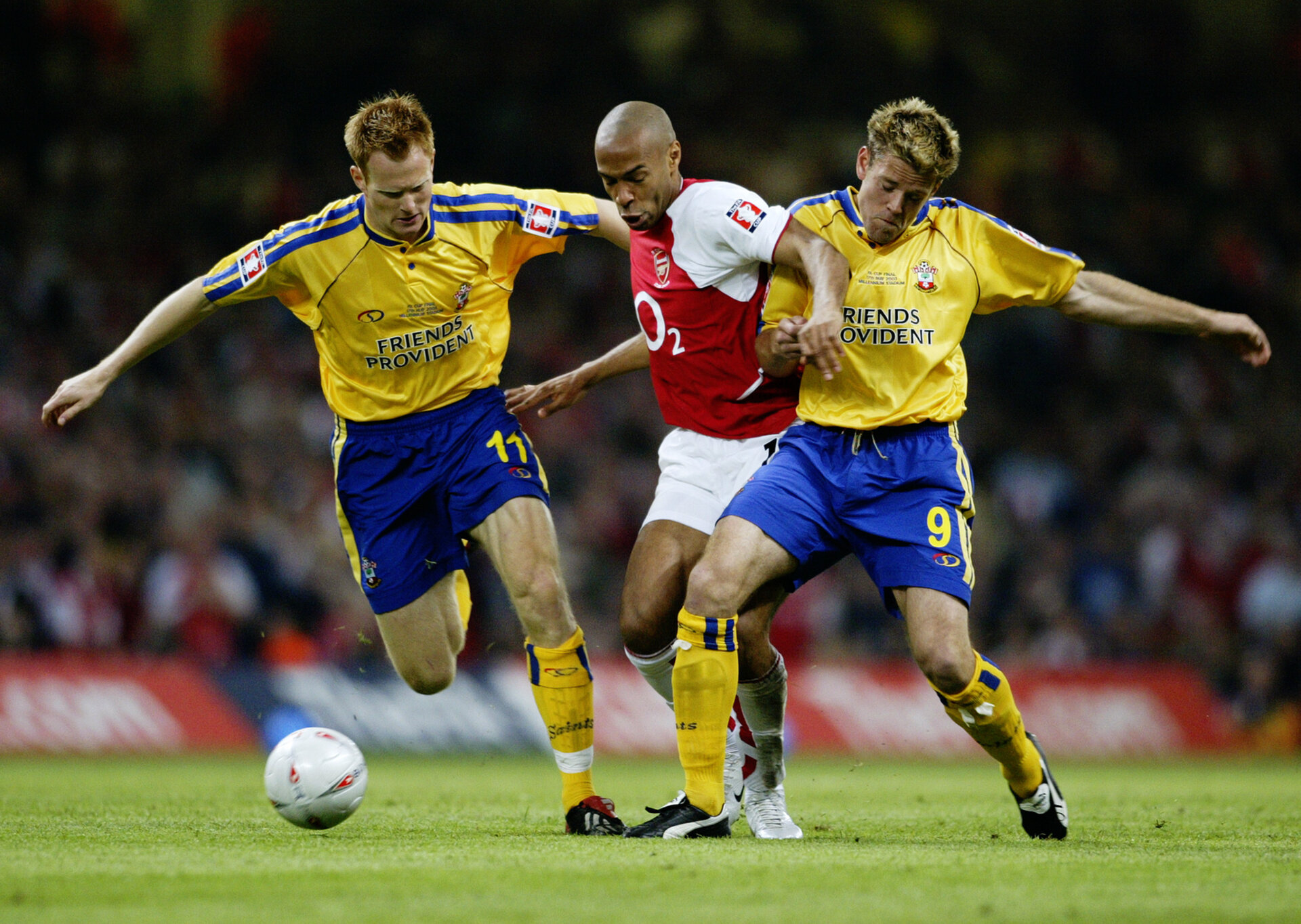 CARDIFF - MAY 17:  Thierry Henry of Arsenal skips past Michael Svensson and James Beattie of Southampton during the FA Cup Final match between Arsenal and Southampton on May 17, 2003 at the Millennium Stadium in Cardiff, Wales.  Arsenal won the match and the FA cup 1-0.  (Photo by Clive Mason/Getty Images)