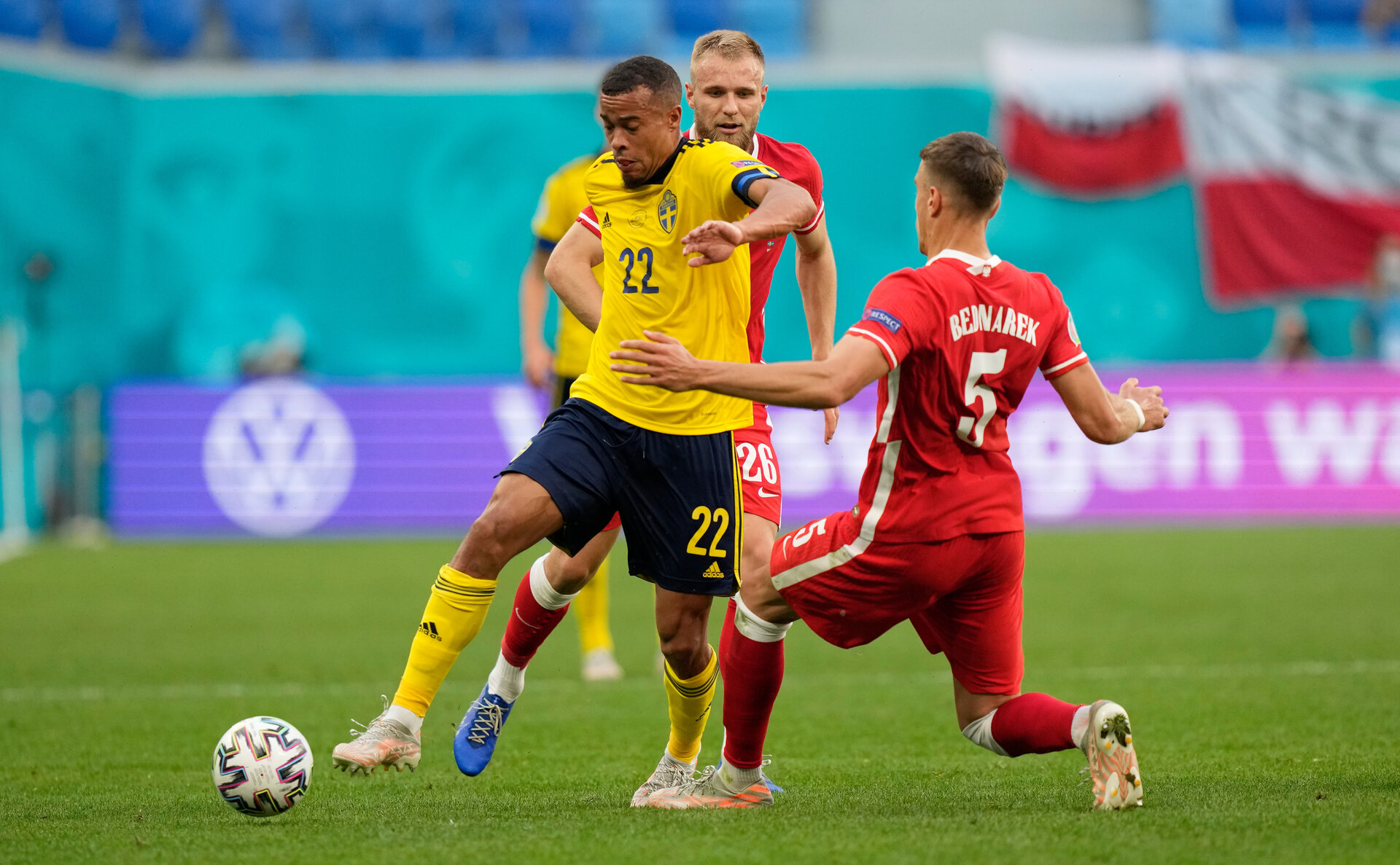 SAINT PETERSBURG, RUSSIA - JUNE 23: Robin Quaison of Sweden is challenged by Jan Bednarek of Poland during the UEFA Euro 2020 Championship Group E match between Sweden and Poland at Saint Petersburg Stadium on June 23, 2021 in Saint Petersburg, Russia. (Photo by Dmitry Lovetsky - Pool/Getty Images)