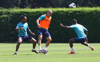 SOUTHAMPTON, ENGLAND - JULY 19: Theo Walcott(L) and Oriol Romeu(centre) during a Southampton FC pre season training session at the Staplewood Campus on July 19, 2021 in Southampton, England. (Photo by Matt Watson/Southampton FC via Getty Images)