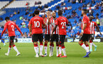 CARDIFF, WALES - JULY 27: Che Adams(10) of Southampton celebrates with his team mates after scoring during the Pre-Season Friendly match between Cardiff City and Southampton at Cardiff City Stadium on July 27, 2021 in Cardiff, Wales. Photo by Matt Watson/Southampton FC via Getty Images