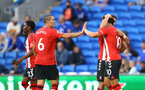 CARDIFF, WALES - JULY 27: Oriol Romeu of Southampton congratulates Che Adams(R) after scoring during the Pre-Season Friendly match between Cardiff City and Southampton at Cardiff City Stadium on July 27, 2021 in Cardiff, Wales. Photo by Matt Watson/Southampton FC via Getty Images