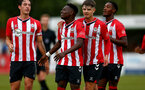 SOUTHAMPTON, ENGLAND - July 27: Kazeem Olaigbe(L) of Southampton and Trialist 1(R) of Southampton during pre season friendly between AFC Totton and Southampton B Team at Snows Stadium on July 27, 2021 in Southampton, England. (Photo by Isabelle Field/Southampton FC via Getty Images)