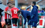 SOUTHAMPTON, ENGLAND - July 27: Will Ferry(L) and Dave Horseman(R) Southampton B Team head coach during pre season friendly between AFC Totton and Southampton B Team at Snows Stadium on July 27, 2021 in Southampton, England. (Photo by Isabelle Field/Southampton FC via Getty Images)