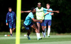 CARDIFF, WALES - JULY 29: Nathan Tella(L) makes a catch during a warm up exercise in front of Moussa Djenepo during a Southampton FC pre season training session at the Vale Resort, Vale of Glamorgan on July 29, 2021 in Cardiff, Wales. (Photo by Matt Watson/Southampton FC via Getty Images)