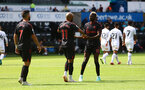 SWANSEA, WALES - JULY 31: Nathan Redmond(11) of Southampton is congratulated by Moussa Djenepo(R) during the pre-season friendly match between Swansea City and Southampton FC, at The Liberty Stadium on July 31, 2021 in Swansea, Wales. (Photo by Matt Watson/Southampton FC via Getty Images)