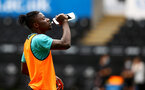 SWANSEA, WALES - JULY 31: Mohammed Salisu of Southampton warms up during the pre-season friendly match between Swansea City and Southampton FC, at The Liberty Stadium on July 31, 2021 in Swansea, Wales. (Photo by Matt Watson/Southampton FC via Getty Images)