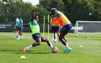 SOUTHAMPTON, ENGLAND - AUGUST 03: Michael Obafemi(L) and Moussa Djenepo during a Southampton FC pre season training session at the Staplewood Campus on August 03, 2021 in Southampton, England. (Photo by Matt Watson/Southampton FC via Getty Images)