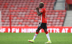SOUTHAMPTON, ENGLAND - AUGUST 07: Moussa Djenepo of Southampton takes on an energy gel during the pre season friendly match between Southampton FC and Athletic Club at St Mary's Stadium on August 07, 2021 in Southampton, England. (Photo by Matt Watson/Southampton FC via Getty Images)
